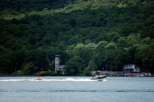 A boat dragging a tube seen on Greenwood Lake on Wednesday, August 8, 2018.