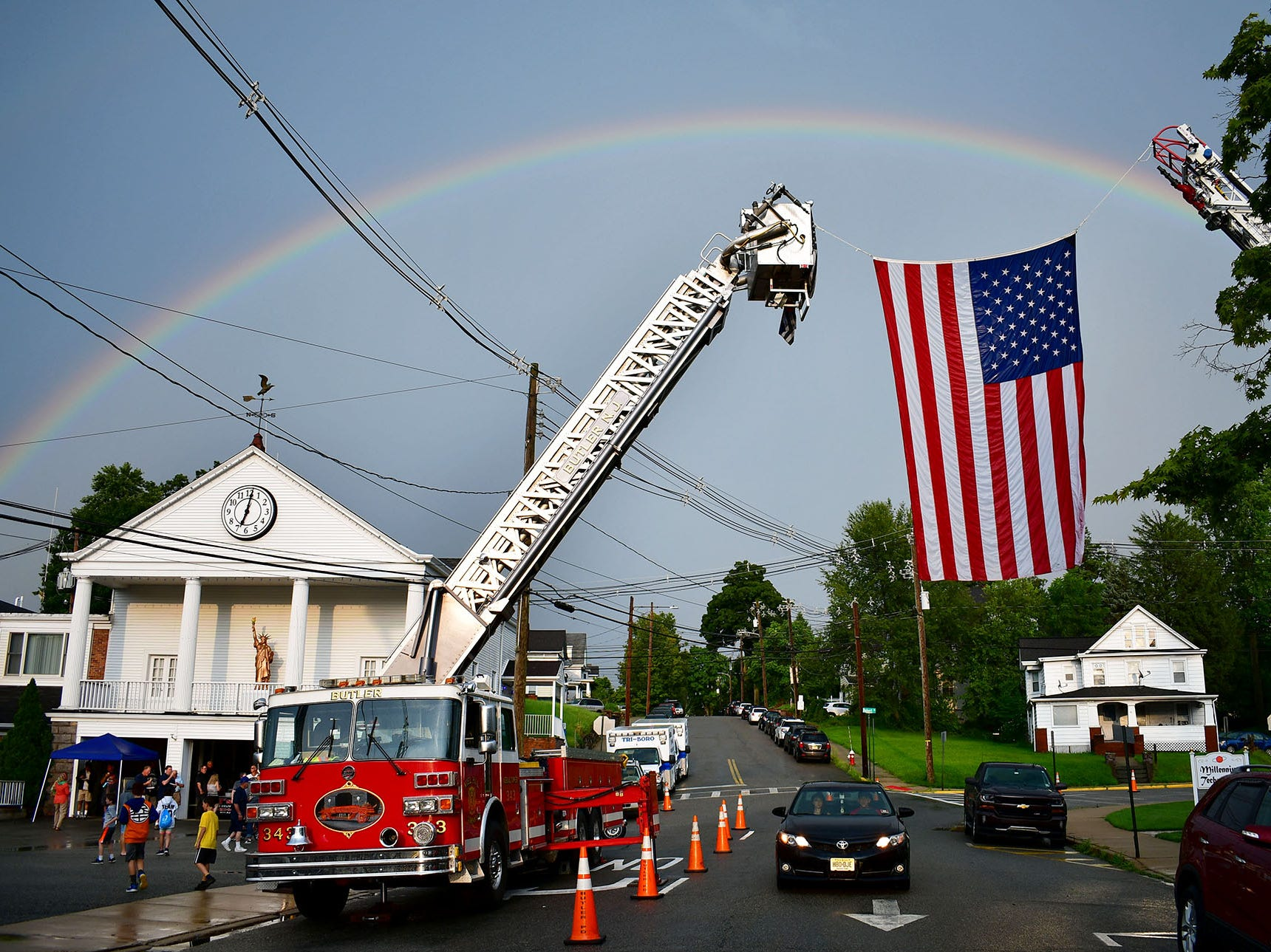 Butler Police Station hosts National Night Out.  Heavy rain hit and then a rainbow appeared after it, over the station.  In Butler on Tuesday eveningl August 07, 2018.