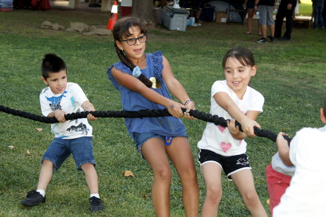 A popular venue at the Deming MainStreet National Night out was the tug-o-war. Children and adults challenge each other in a spirited contest.
