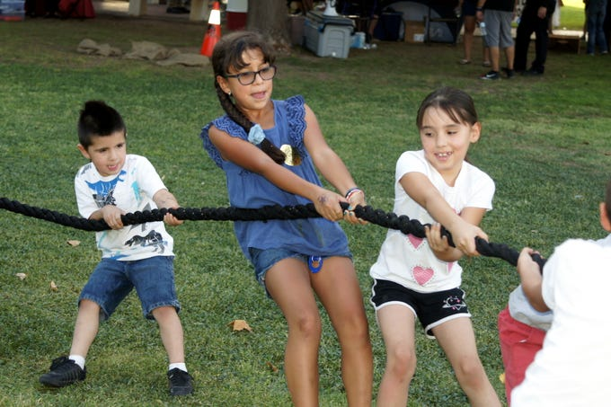 One popular venue at Tuesday's second annual National Night out was the tug-o-war. Children and adults challenged each other in a spirited contest.