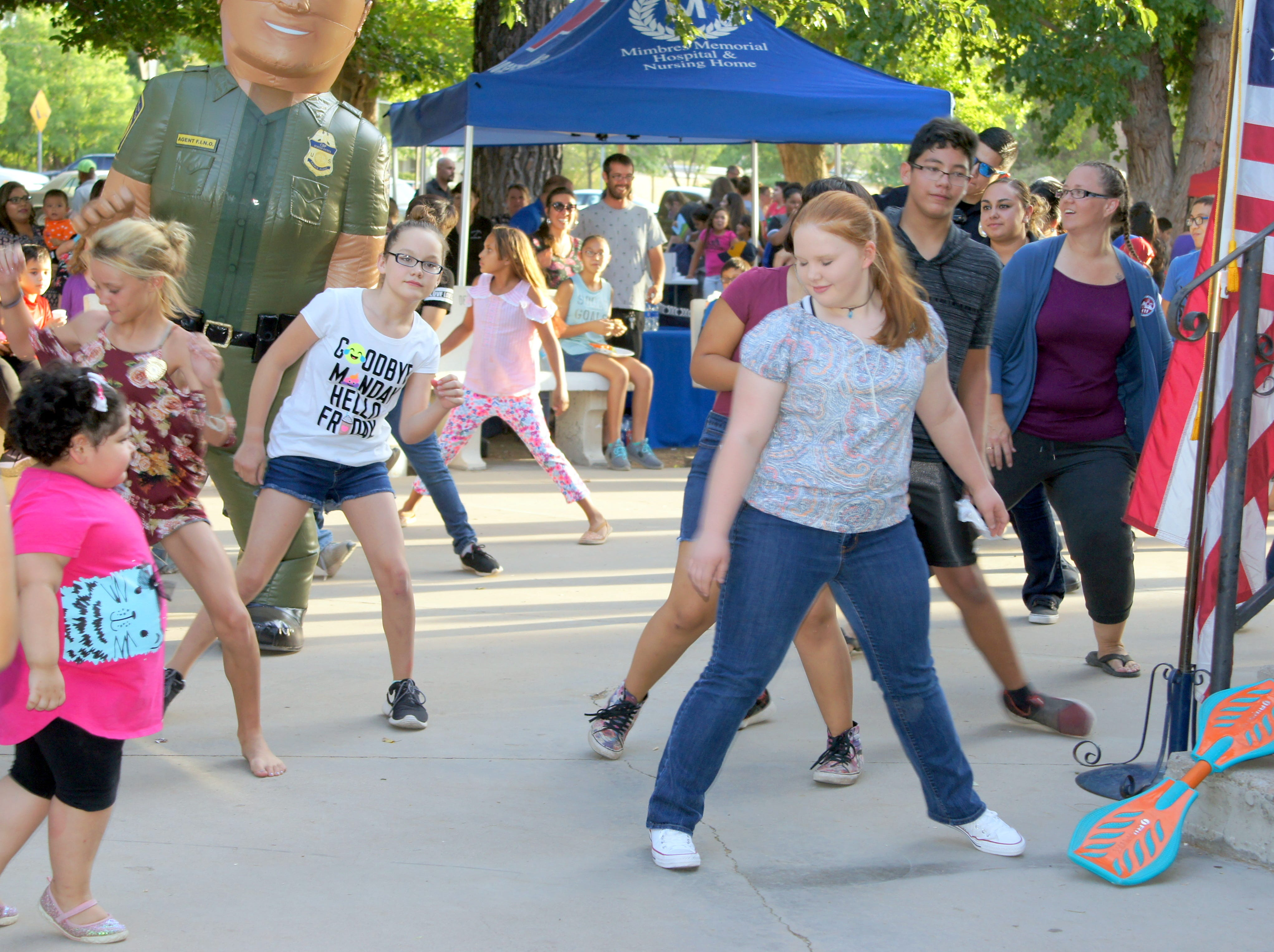 DJ Richard Gallosa and his Making Memories entertainment service kept children and adults active on the dance floor during Tuesday's second annual National Night Out event at Luna County Courthouse Park in Deming, NM.