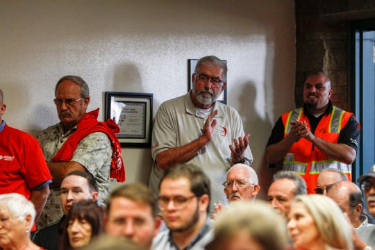 """Union members listen to comments on a proposed """"right to work"""" measure during a San Juan County Commission meeting Tuesday in Aztec."""