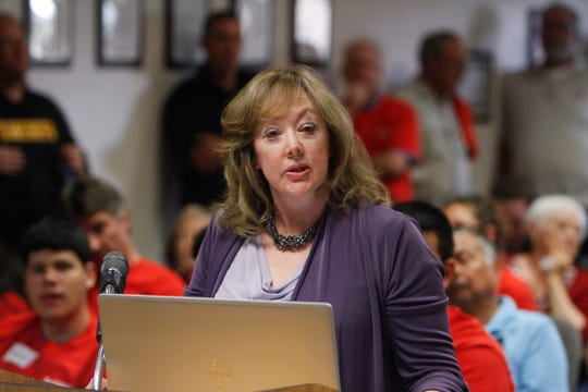 "Carla Sonntag, president of the New Mexico Business Coalition, speaks in favor of the ""right to work"" ordinance Tuesday during a San Juan County Commission meeting in Aztec."