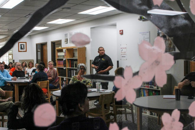 San Juan County Sheriff's Office School Resource Officer Donnie Kee speaks to teachers during a safety and survival seminar for school employees Wednesday at Aztec High School.