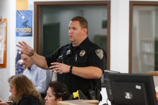 Aztec Police Department School Resource Officer John Welch addresses listeners Wednesday during a safety and survival seminar for area school employees at Aztec High School.