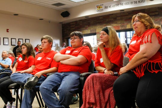 """""""Right to work"""" advocates sit in front Tuesday during a San Juan County Commission meeting in Aztec."""