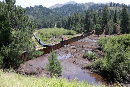 A temporary steel dam held it owns during heavy rain and fluctauting water levels.