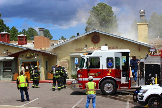 Ruidoso emergency respondents at Farley's Restaurant after a fire broke out in the attic.