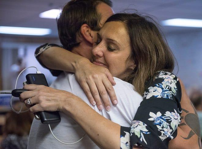 Dayna Polehanki hugs her husband, Joseph Walkup, after a long day at the polls.