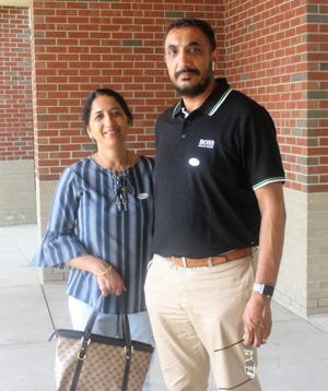 Canton residents Sukhi and Rudinderjit Narwar after casting their ballots.