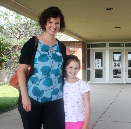 Canton resident Brianna Lara brought her daughter when she cast her ballot at Workman Elementary School.