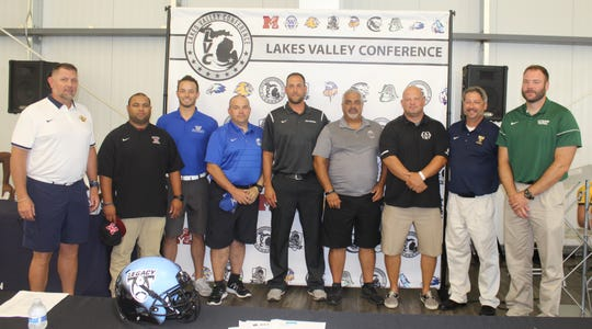 The Lakes Valley Conference's nine football head coaches posed for a photo at the inaugural media day. The group includes (from left) Jeff Henson (South Lyon), Garfrey Smith (Milford), Alex Grignon (W.L. Western), Joe Woodruff (Lakeland), Joe Pesci (South Lyon East), Joe Boulus (W.L. Northern), Chris Fahr (Waterford Mott), Bob Meyer (W.L. Central) and Kenny Schmidt (Waterford Kettering).
