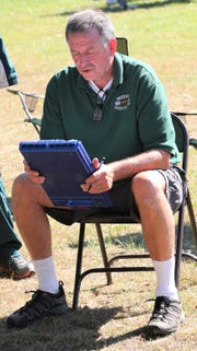 Novi's Robert Smith was a Hall of Fame boys cross country coach for the Wildcats.