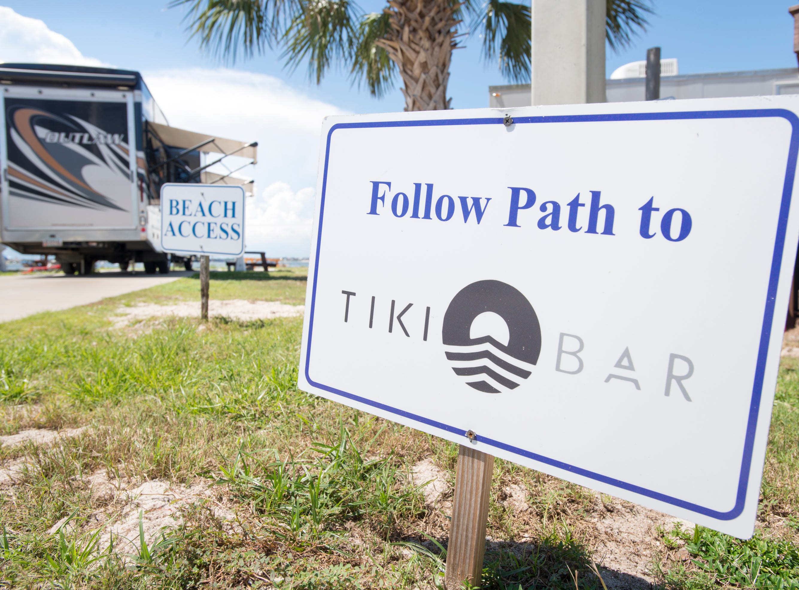 Sign leading to the Tiki Bar at the Pensacola Beach RV Resort in Pensacola on Tuesday, August 7, 2018.