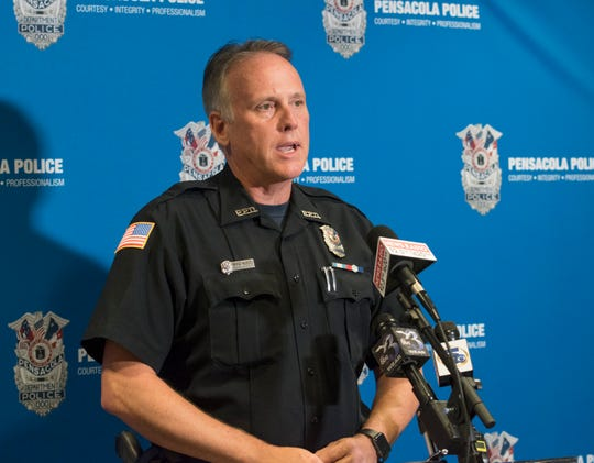 Public information officer Mike Wood talks about the search for an alleged rapist during a press conference at the Pensacola Police Department on Tuesday, August 7, 2018.