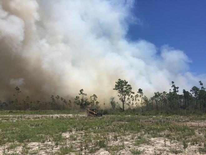 Crews battle 5-acre Bergren Road fire Wednesday, Aug. 8, 2018.