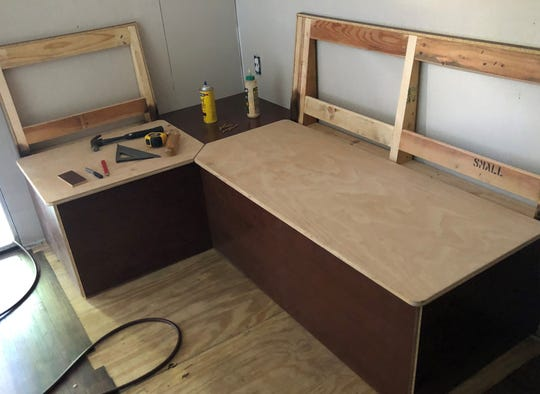 Seating is being constructed for the Emerald Coast Alliance for Breastfeeding Support's mobile trailer that will provide a safe, clean and cool spot for breastfeeding moms at local outdoor events.