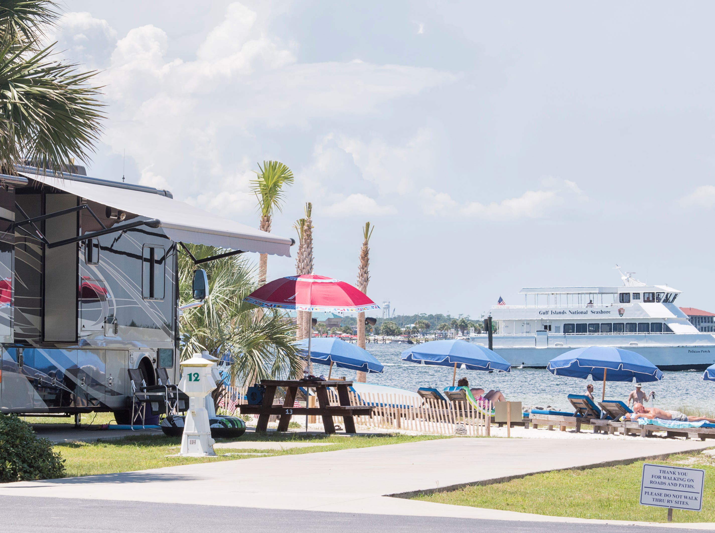 Guests enjoy the sun and sand at the Pensacola Beach RV Resort in Pensacola on Tuesday, August 7, 2018.