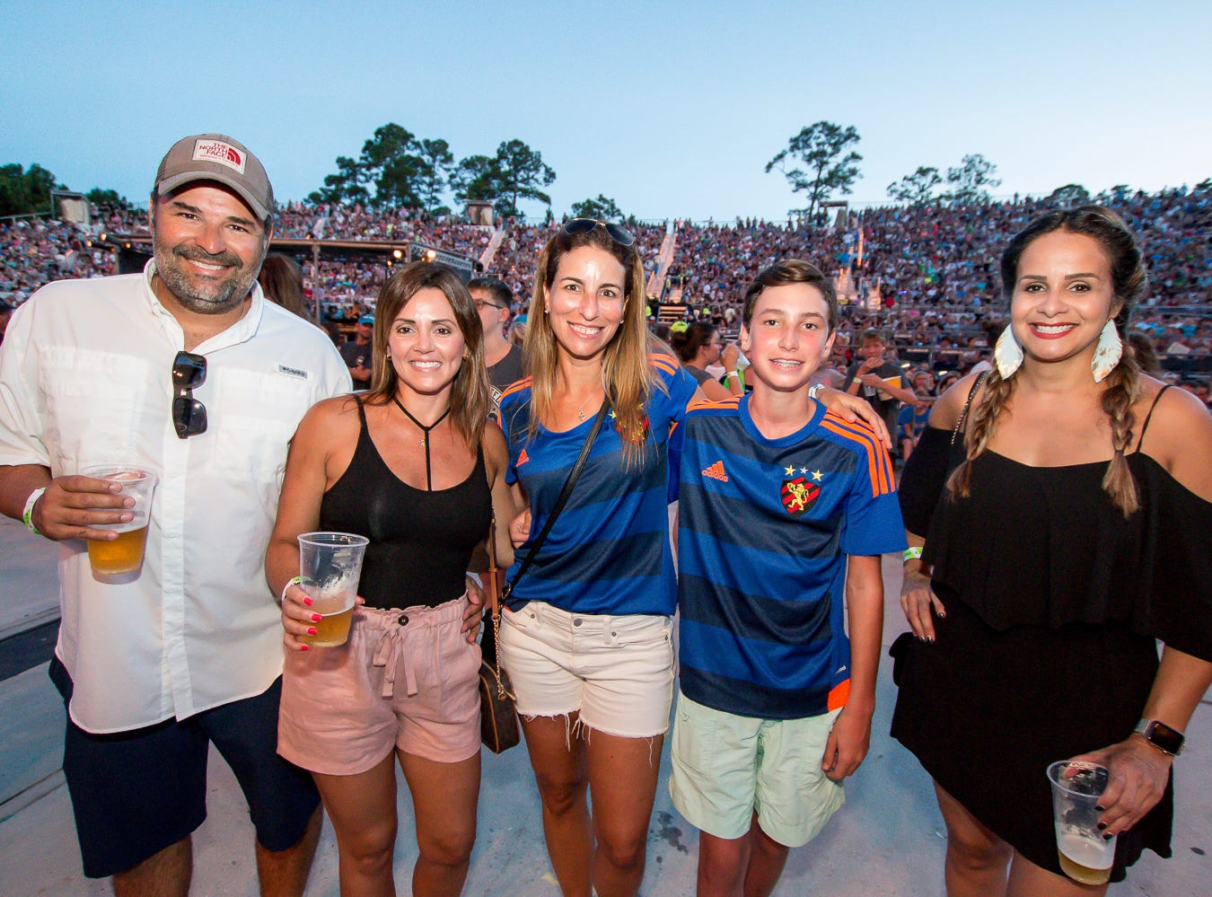 Fans before the start of the near-capacity Imagine Dragons concert during the Evolve World Tour stop at the Wharf Amphitheater in Orange Beach on Tuesday, August 7, 2018. Grace VanderWaal opened the show.