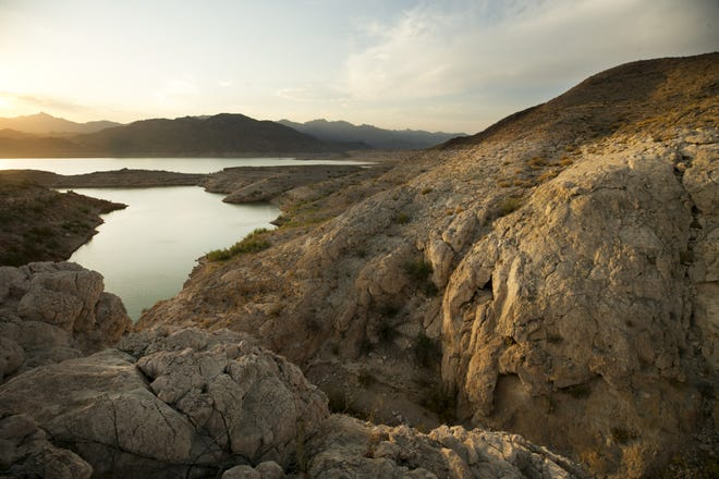 A line along a cliff illustrates where the surface of Lake Mead once stood before the reservoir's dramatic decline.