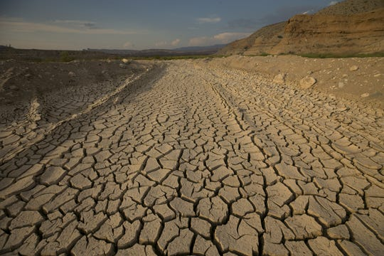 The decline of Lake Mead has left dried silt exposed.