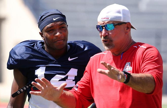 Arizona quarterback Khalil Tate and offensive coordinator Noel Mazzone at practice on Tuesday, Aug. 7, 2018.