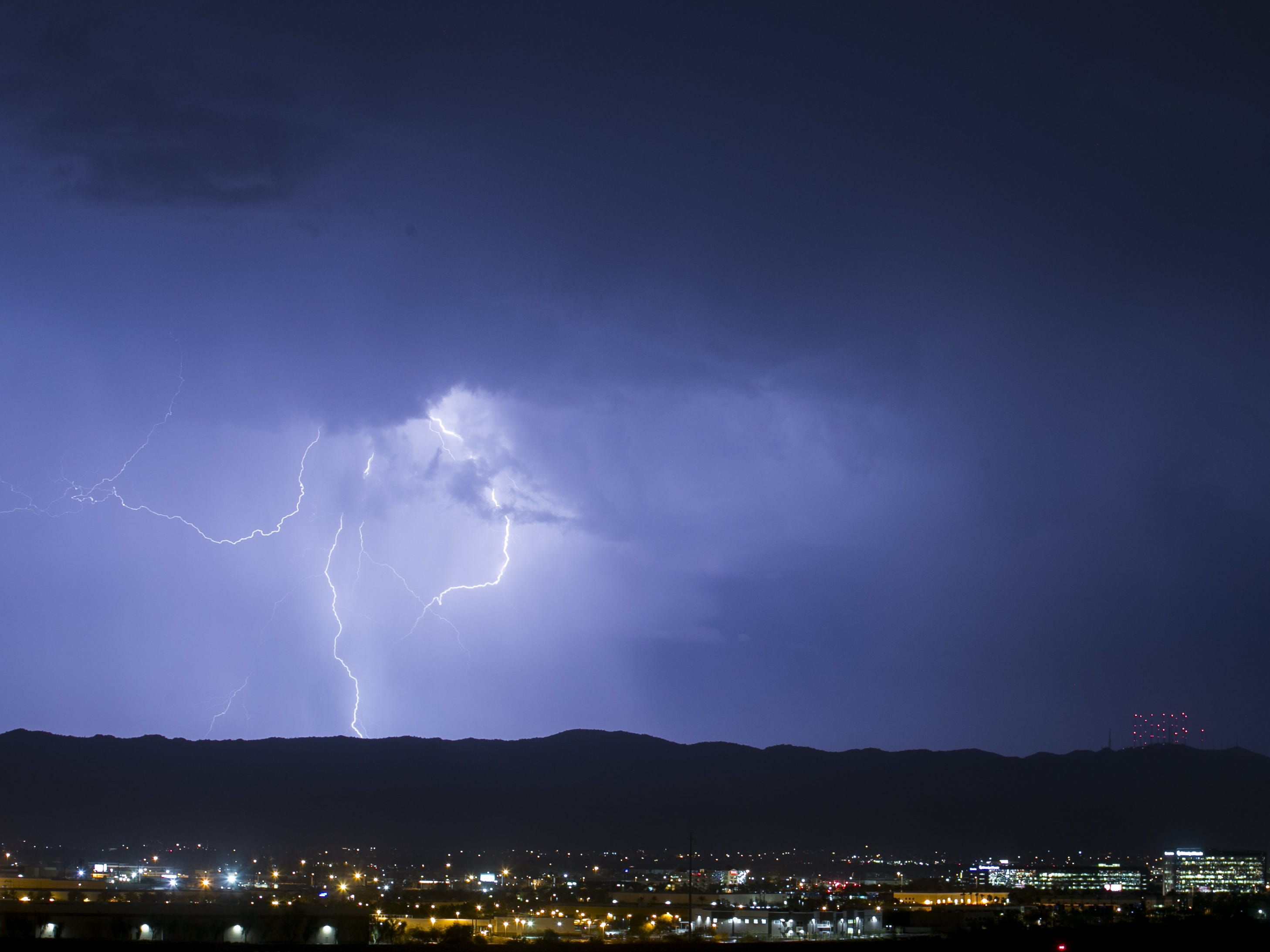 Lightning strikes over South Mountain Park in Phoenix on Aug 7, 2018.