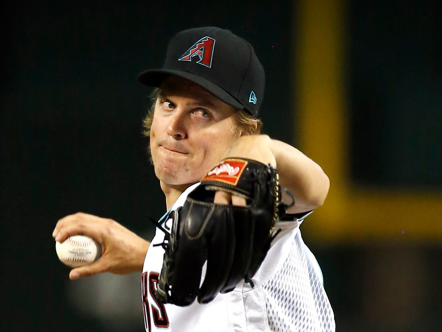 Arizona Diamondbacks pitcher Zack Greinke winds up during the first inning of the team's baseball game against the Philadelphia Phillies, Tuesday, Aug. 7, 2018, in Phoenix.