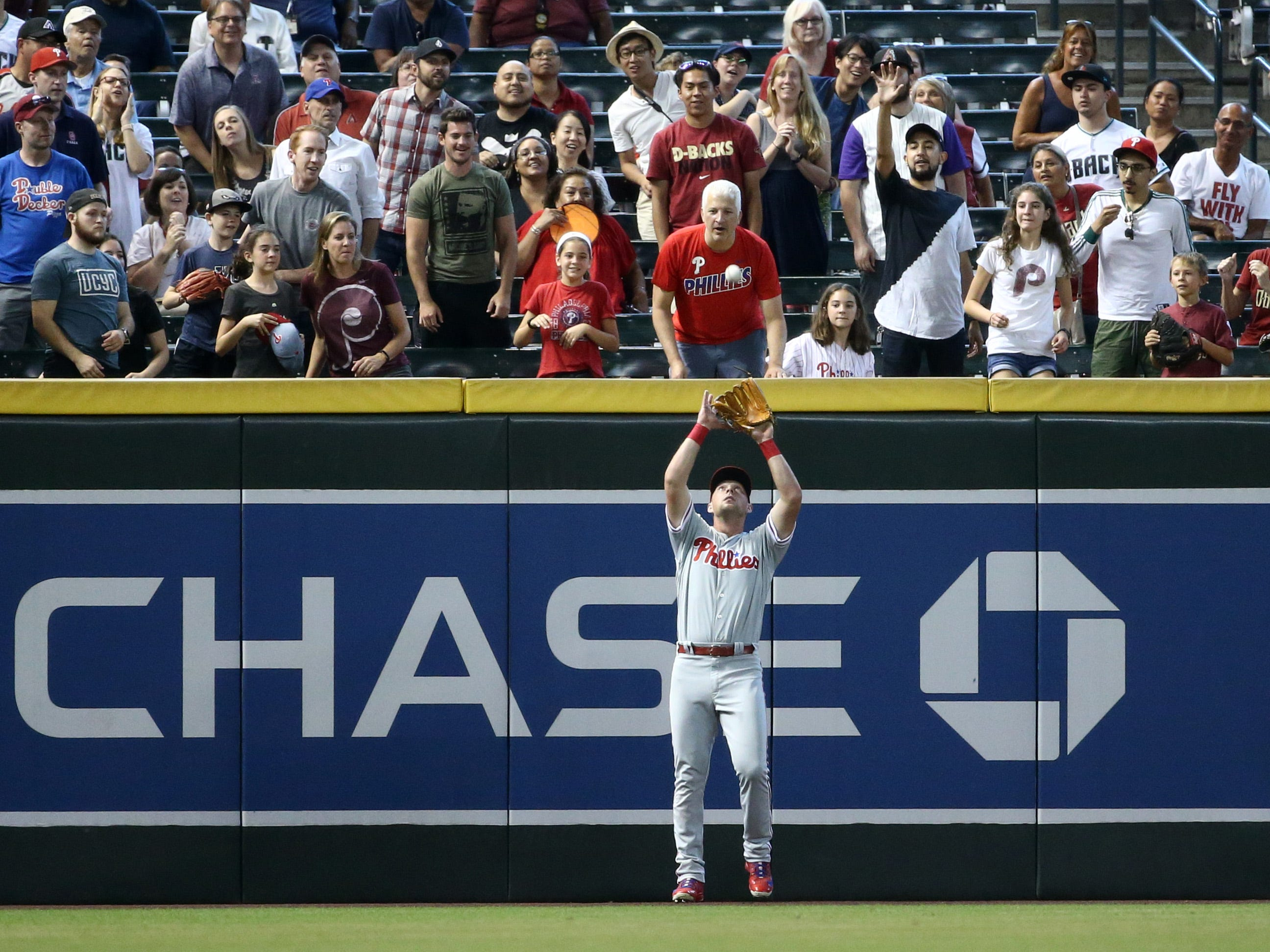 Arizona Diamondbacks A.J. Pollock flies out to Philadelphia Phillies left fielder Rhys Hoskins in the first inning on Aug. 8, 2018, at Chase Field in Phoenix, Ariz.