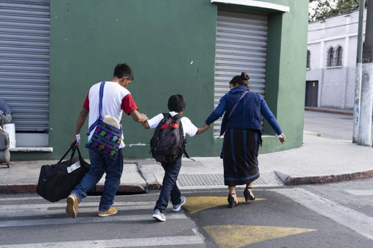 Children leave a shelter after being reunited with their parents, who were deported, in Guatemala on Aug. 7, 2018.