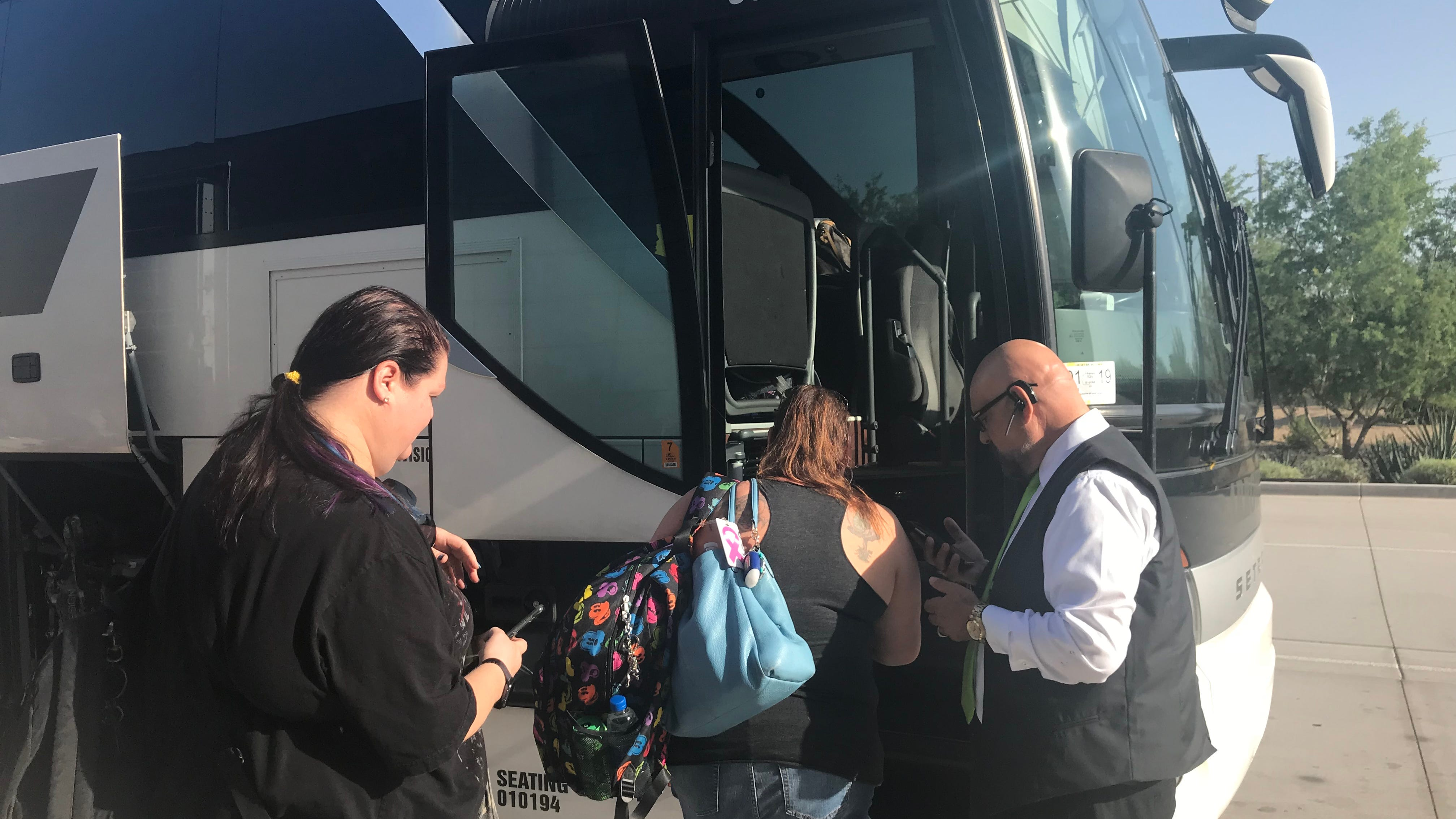 Passengers board a FlixBus at the Phoenix Sky Train Station near Phoenix Sky Harbor International Airport for a six-hour ride to Las Vegas. The buses are usually bright green but this was a last-minute substitution so the trip wasn't canceled.