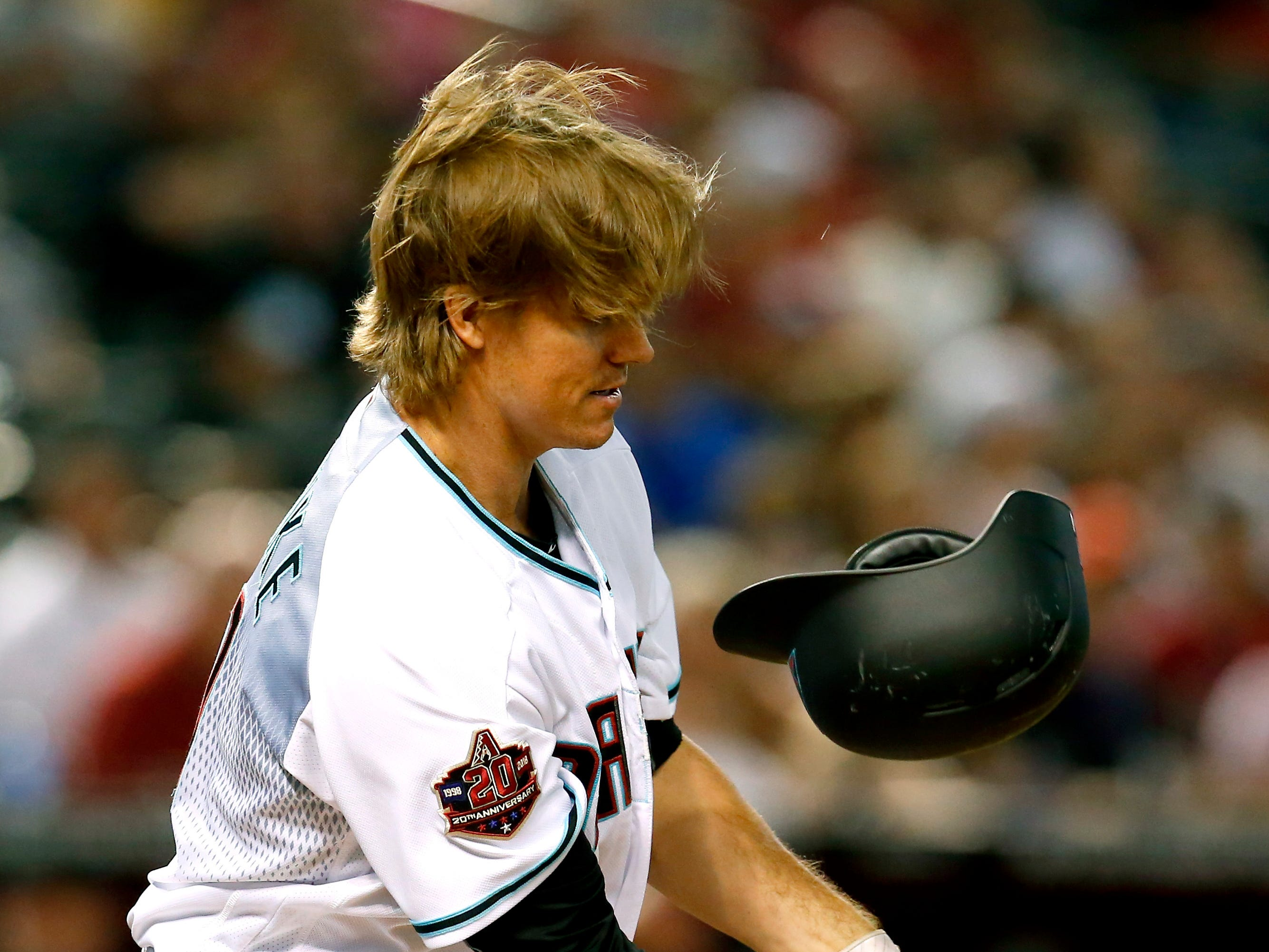 Arizona Diamondbacks' Zack Greinke loses his helmet while batting during the third inning of the team's baseball game against the Philadelphia Phillies, Tuesday, Aug. 7, 2018, in Phoenix.