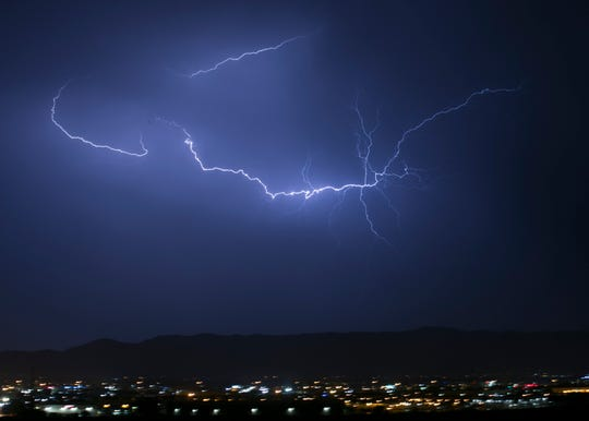 Lighting strikes over South Mountain Park in Phoenix on Aug. 7, 2018.
