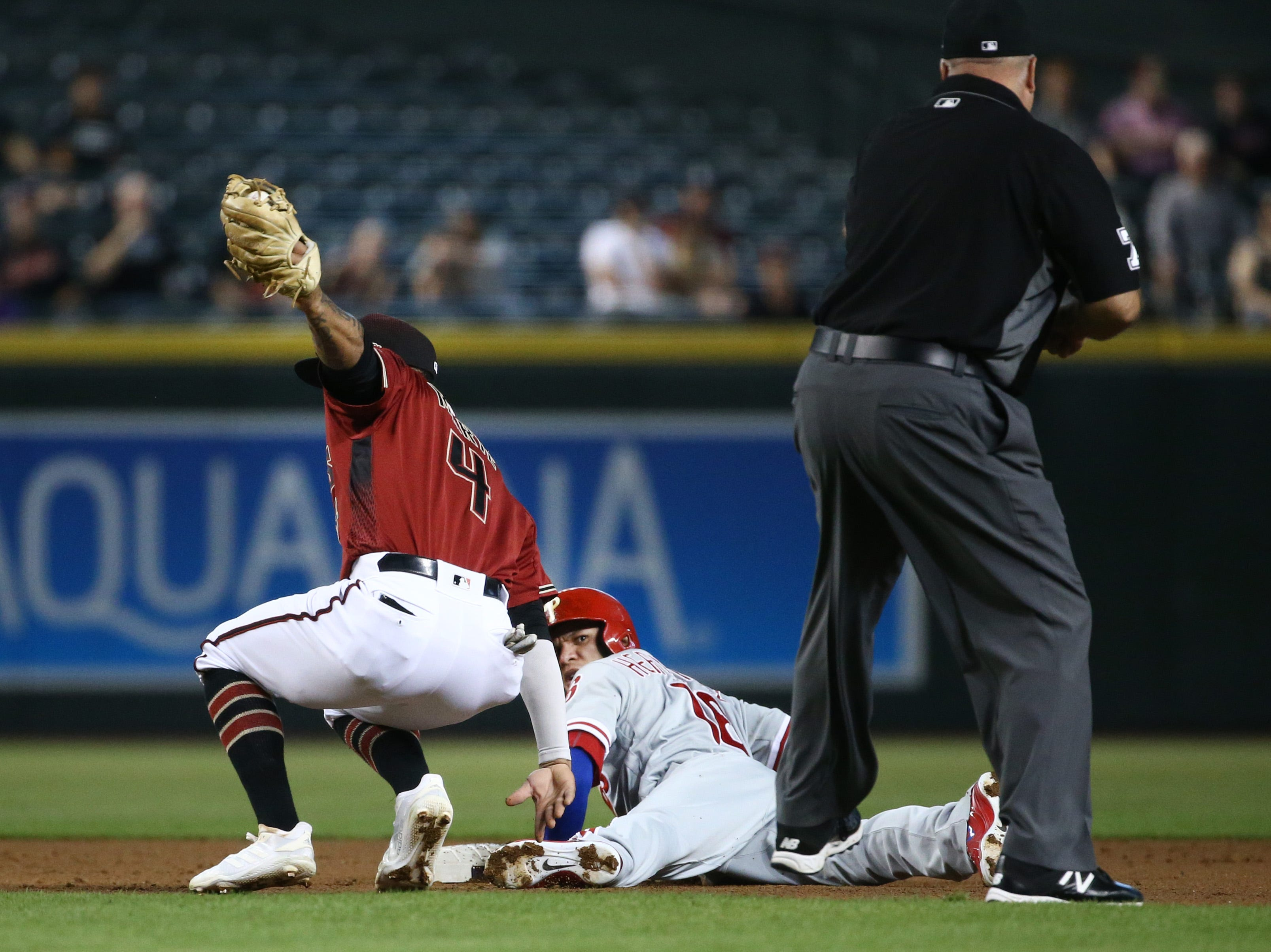 Arizona Diamondbacks Ketel Marte tags out Philadelphia Phillies Cesar Hernandez trying to steal second base in the first inning on Aug. 8, 2018, at Chase Field in Phoenix, Ariz.