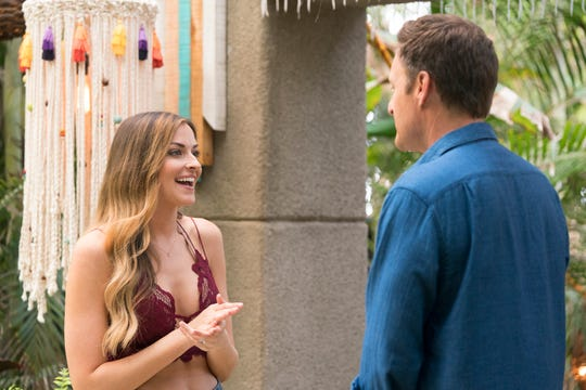 Bachelor in Paradise contestant Tia Booth talks to Bachelor host Chris Harrison.