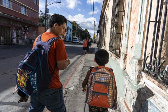 Gilberto Calmo and his son Franklin Noel Calmo Ramirez, 8, leave the shelter after they were reunited in Guatemala City on August 7, 2018. Calmo and his entered the U.S. on March 8 and were separated shortly after. Calmo was deported on June 8.