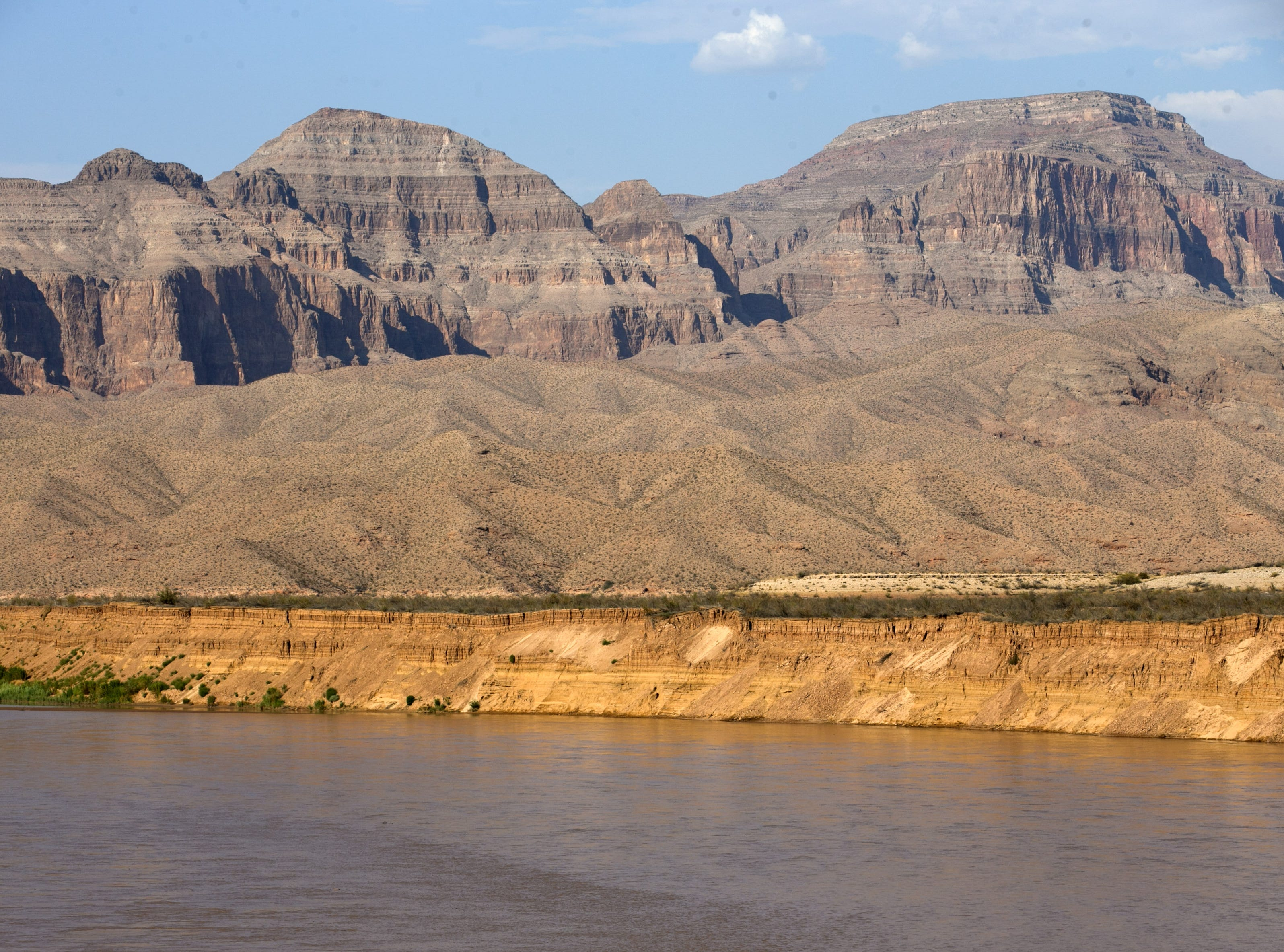 Silt banks tower more than 50 feet above the banks of the Colorado River near Pearce Ferry on Aug. 1, 2018. The silt in the banks, which make the end of the Grand Canyon, in Lake Mead National Recreation Area, came down the Colorado River and could not pass Hoover Dam. The banks were once underwater but now line the river with the lake at near-record-low levels.