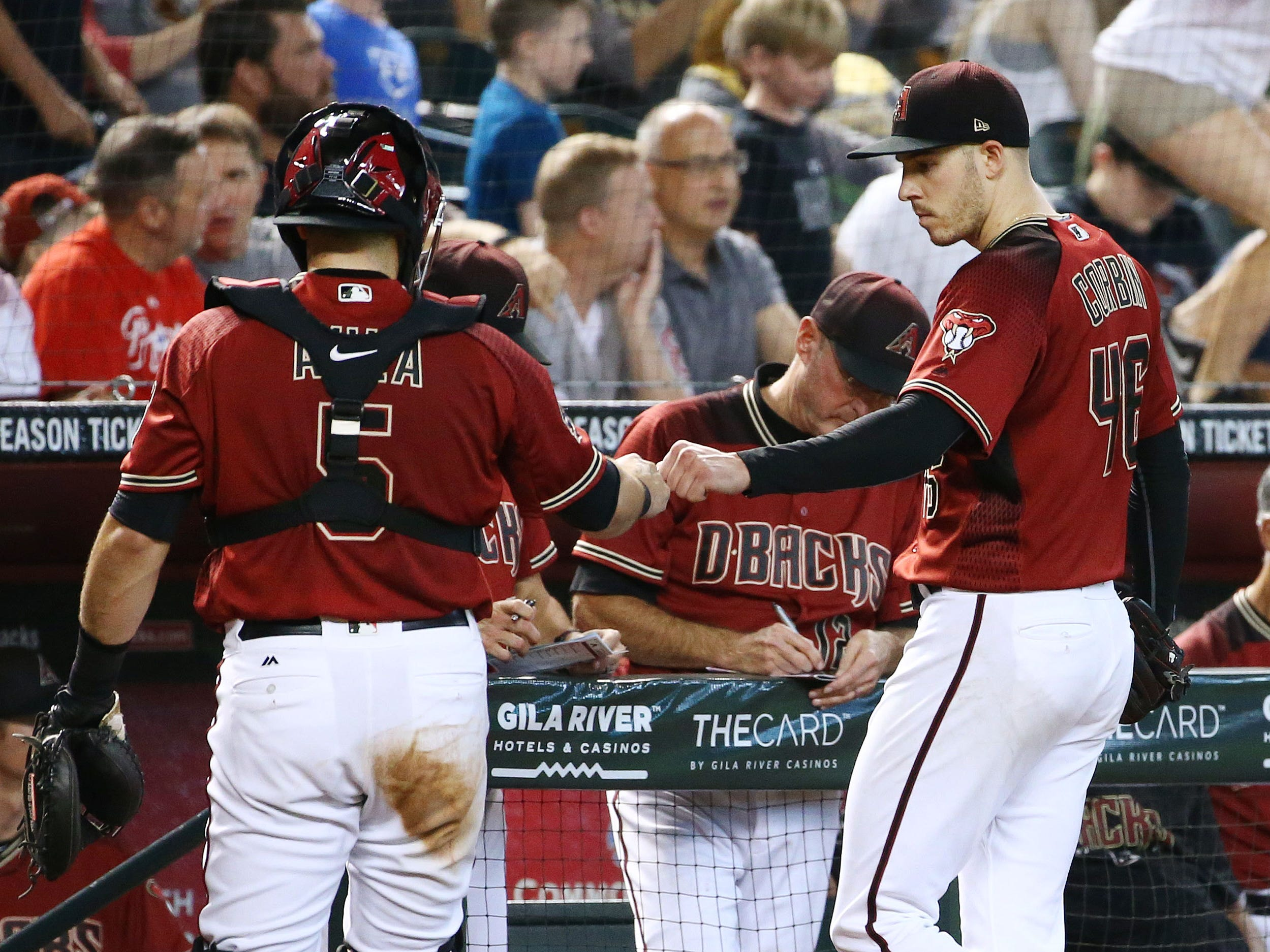 Arizona Diamondbacks Patrick Corbin gives a fist-pump to catcher Alex Avila after holding the Philadelphia Phillies scoreless, on four hits through the seventh inning on Aug. 8, 2018, at Chase Field in Phoenix, Ariz.