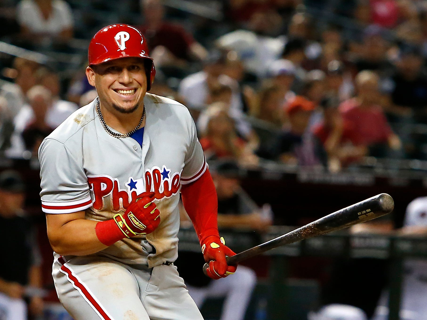 Philadelphia Phillies' Asdrubal Cabrera reacts after a swinging strike during the eighth inning of the team's baseball game against the Arizona Diamondbacks on Tuesday, Aug. 7, 2018, in Phoenix.