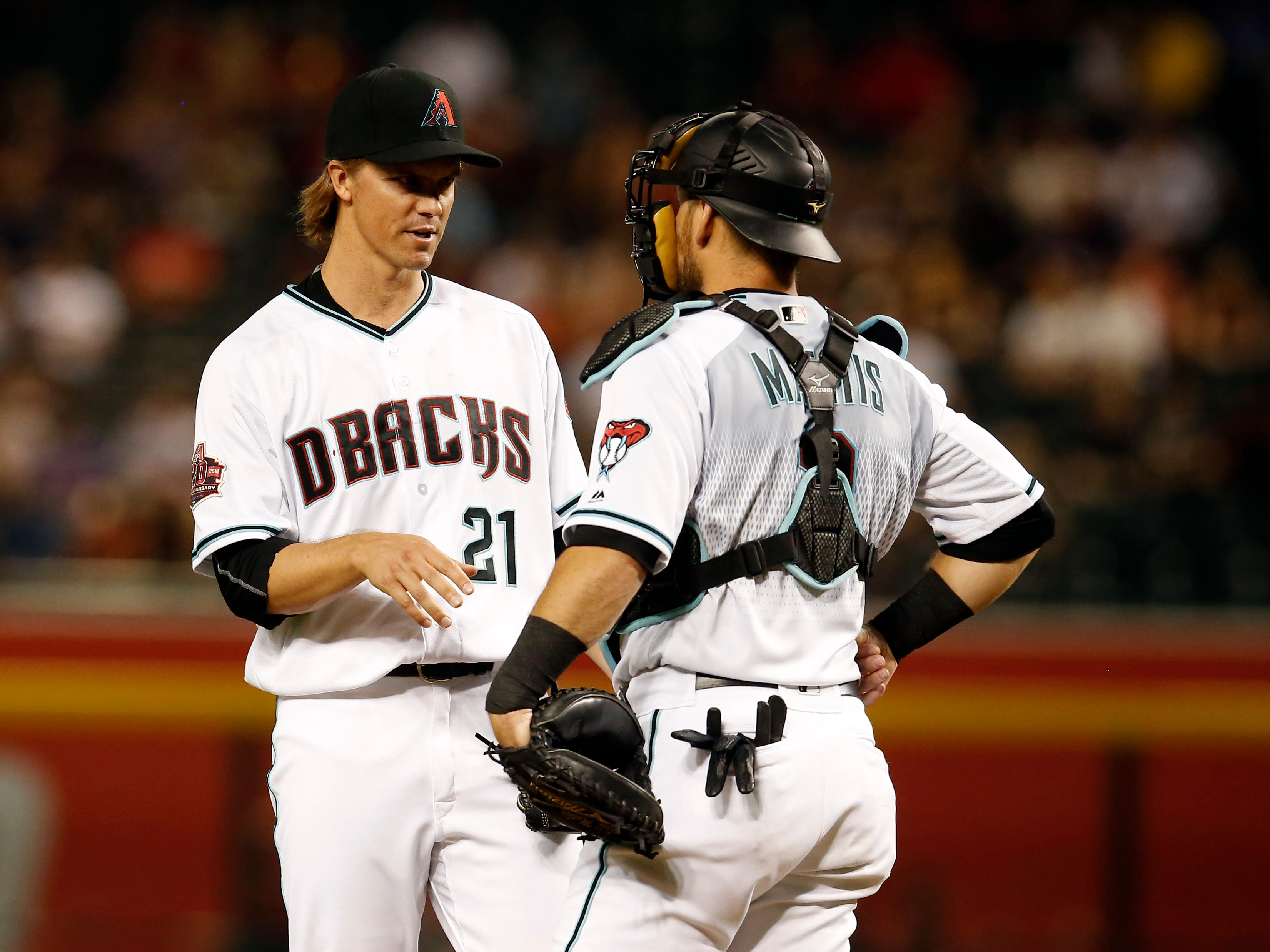Arizona Diamondbacks starting pitcher Zack Greinke (21) in the first inning during a baseball game against the Philadelphia Phillies, Tuesday, Aug. 7, 2018, in Phoenix.
