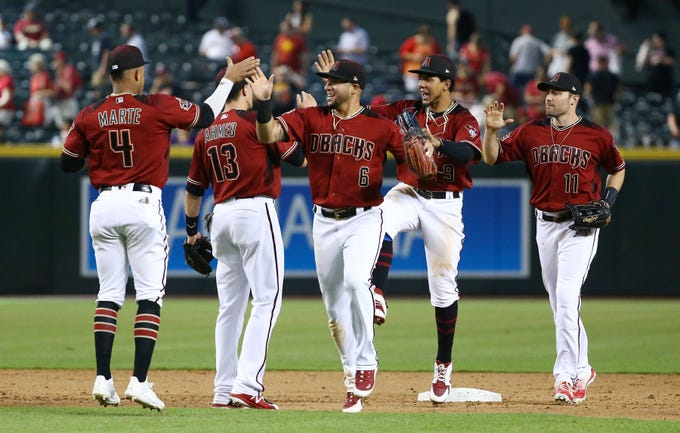 Arizona Diamondbacks Ketel Marte and David Peralta celebrates their 6-0 win over the Philadelphia Phillies on Aug. 8, 2018, at Chase Field in Phoenix, Ariz.