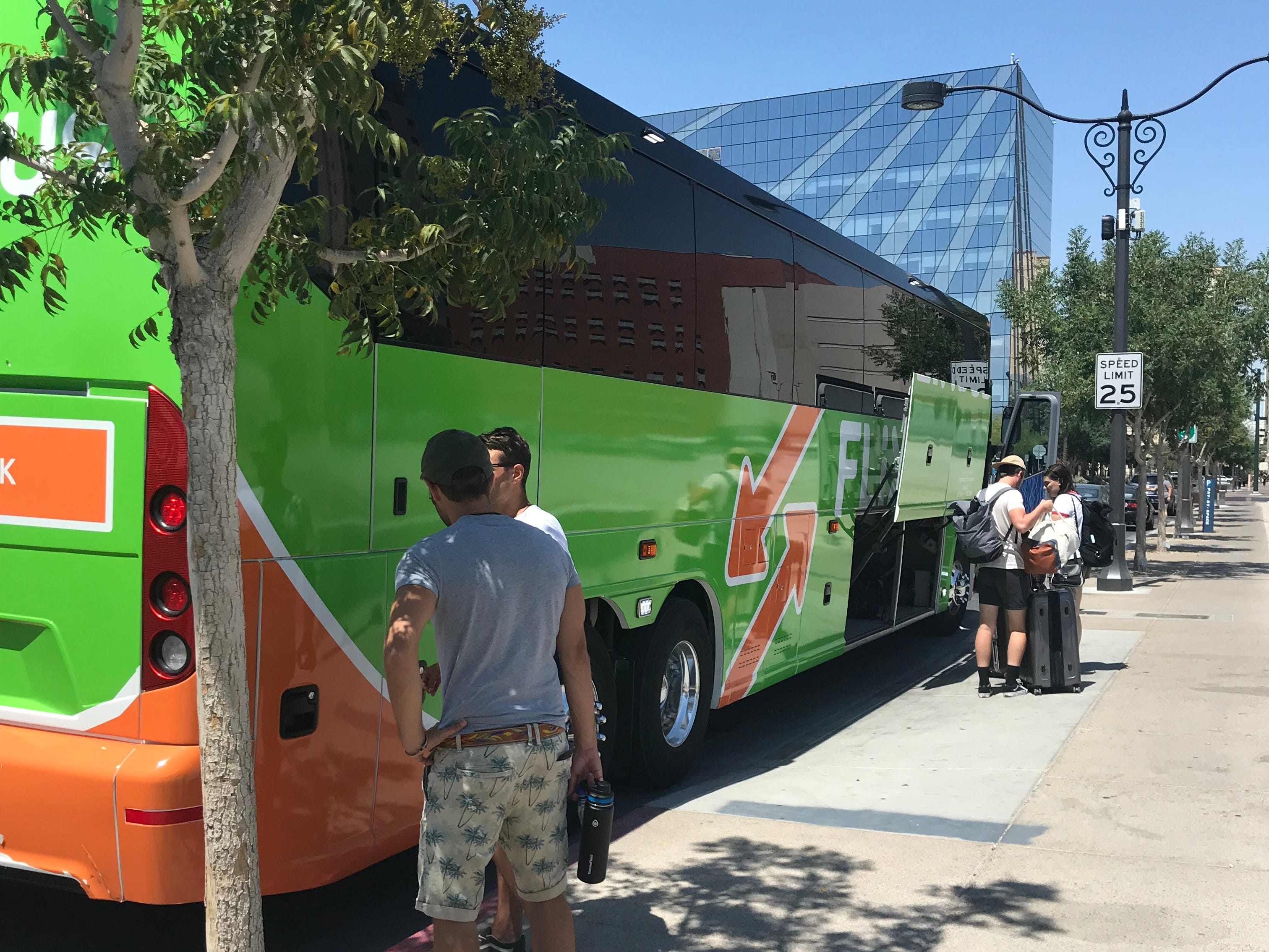 A FlixBus picks up passengers at a stop in downtown Las Vegas. The German company, which just expanded to the United States, is known for its bright green buses.