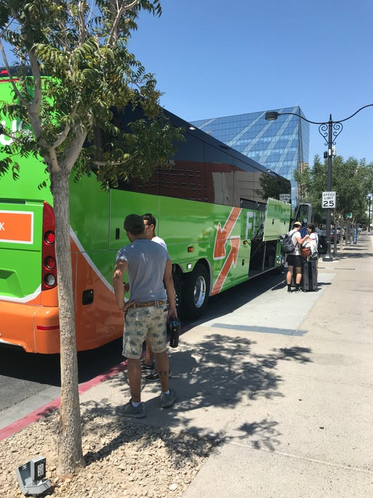 A FlixBus picks up passengers at a stop in downtown Las Vegas. The Germany company, which just expanded to the United States, is known for its bright green buses.
