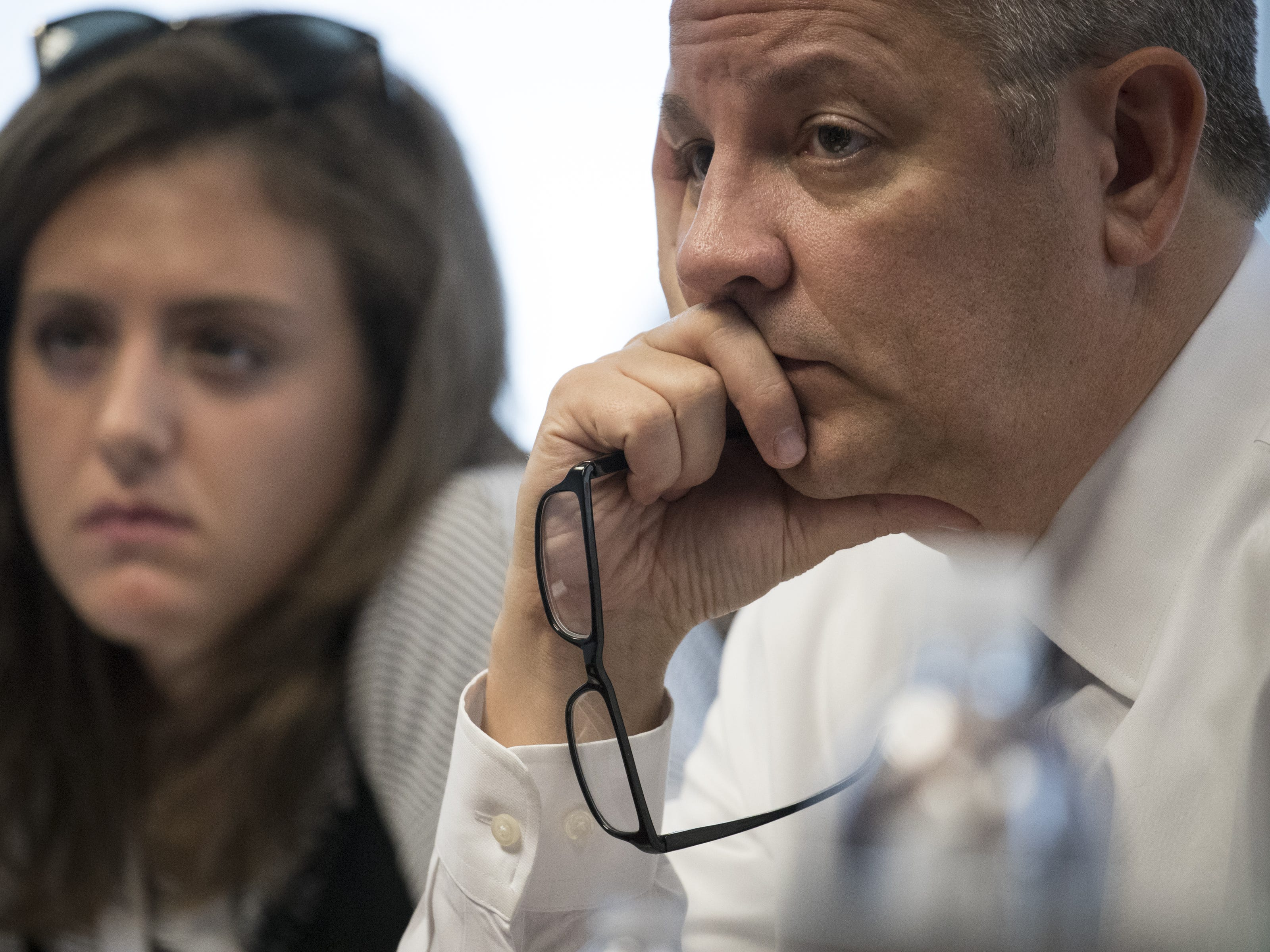 Ron Hansen (right) listens to Jesse Jackson during an interview in the editorial board room on Aug. 8, 2018, at The Arizona Republic.