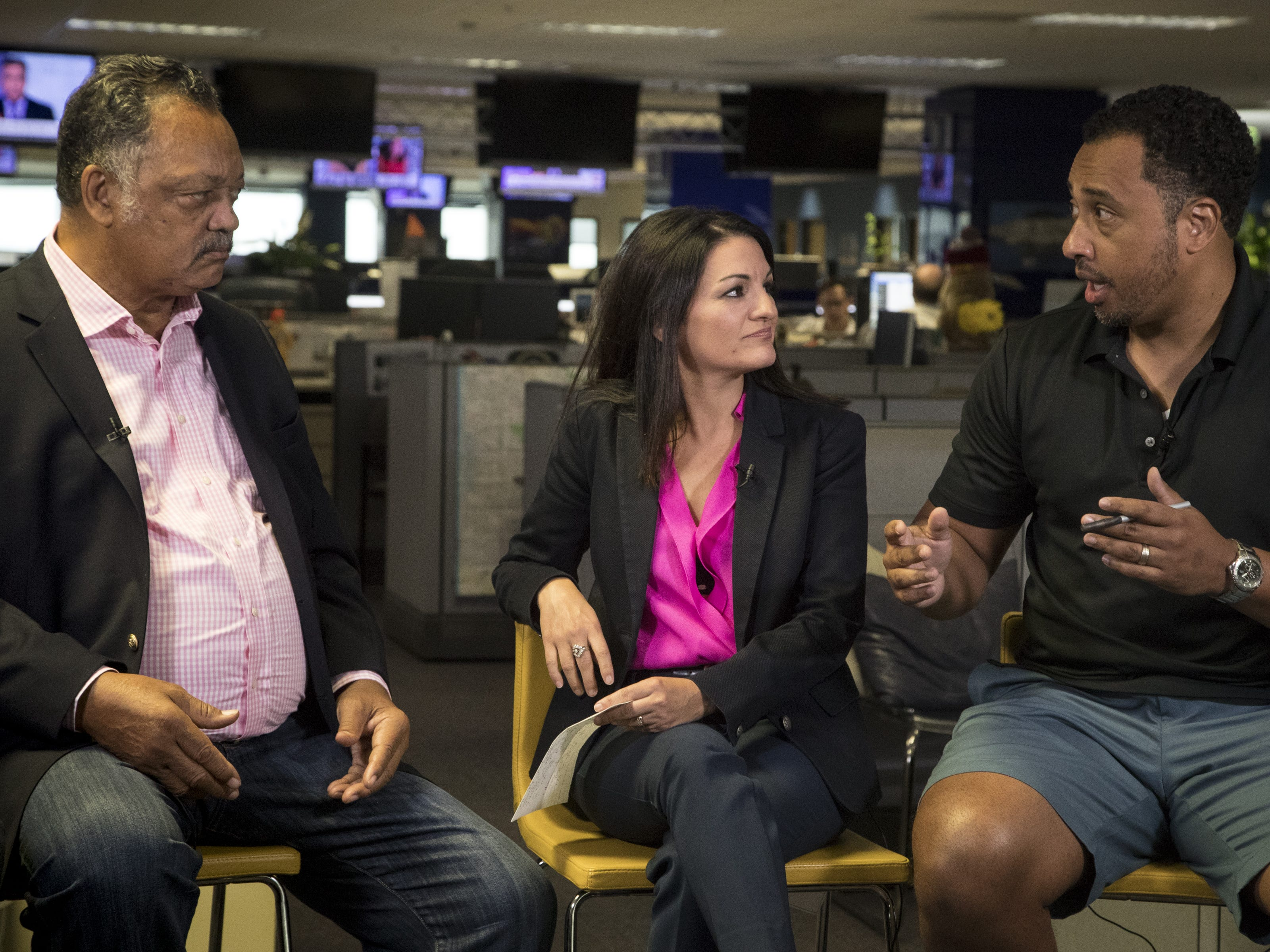 Greg Moore (right) asks Jesse Jackson a question during an interview on Aug. 8, 2018, at The Arizona Republic. Reporter Yvonne Wingett Sanchez (center) looks on.