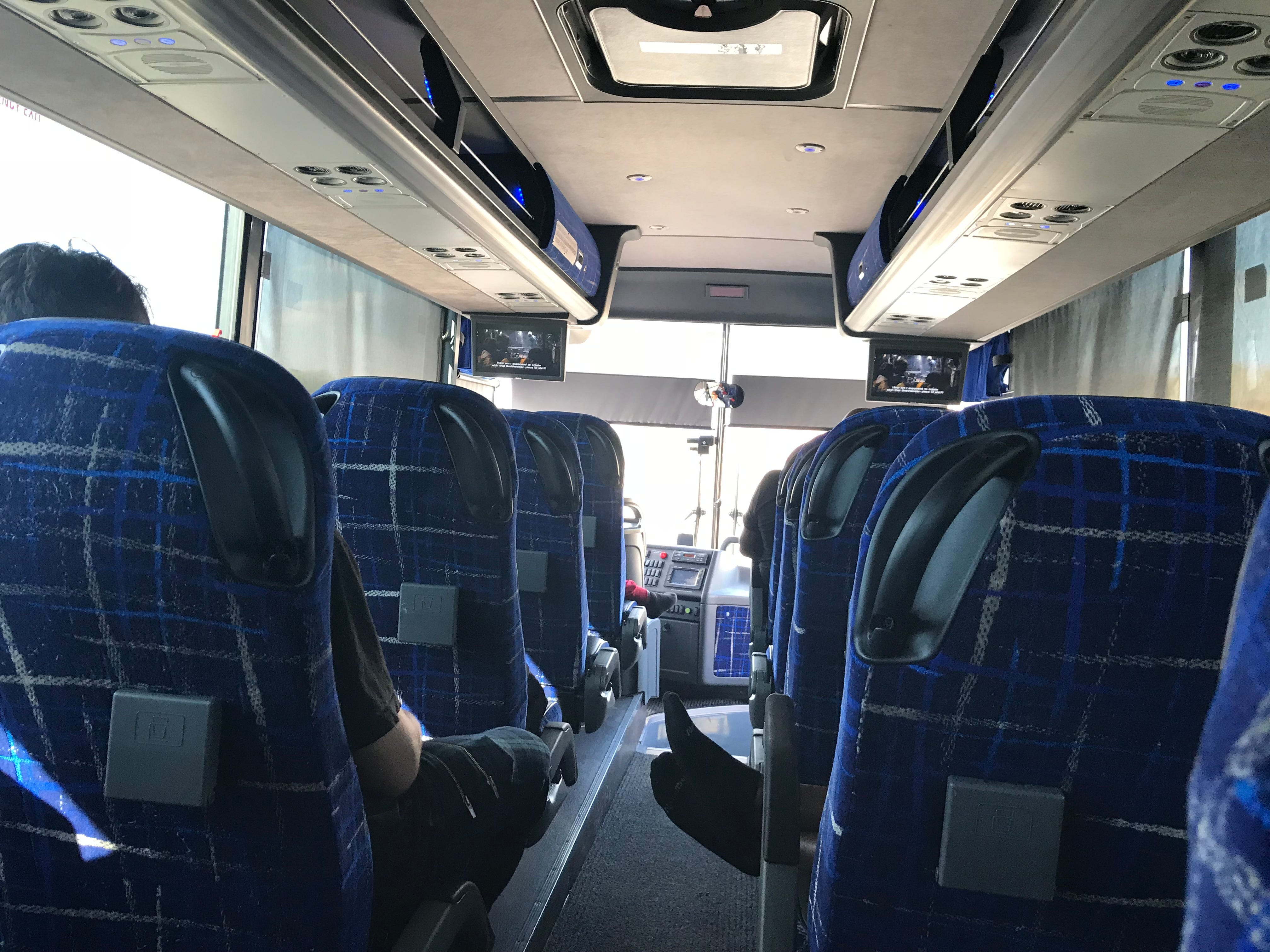Passengers on a Megabus from Las Vegas to Phoenix. The bus driver shows free movies.