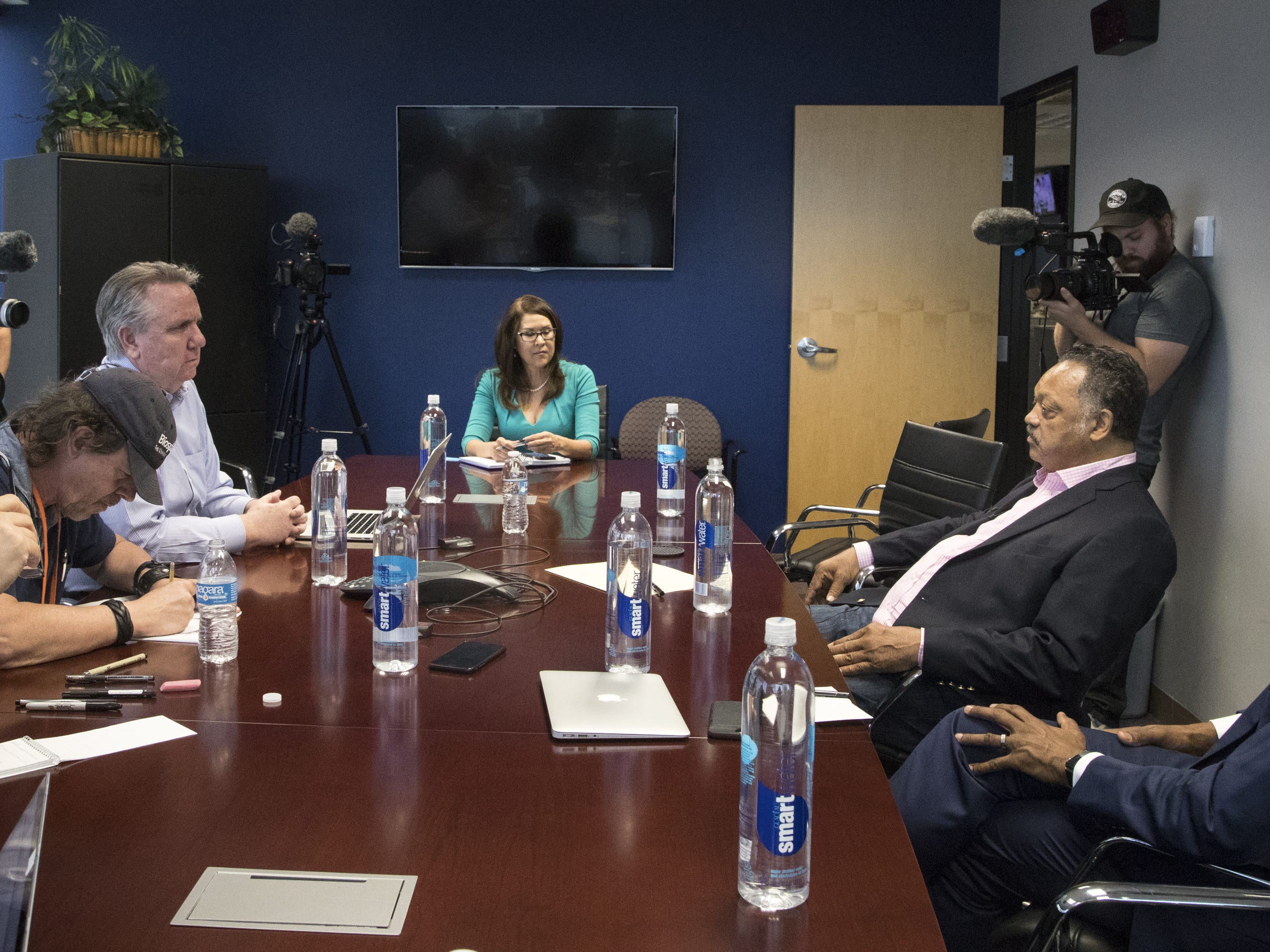 Jesse Jackson (right) answers a question during an interview in the editorial board room, Aug. 8, 2018, at The Arizona Republic.