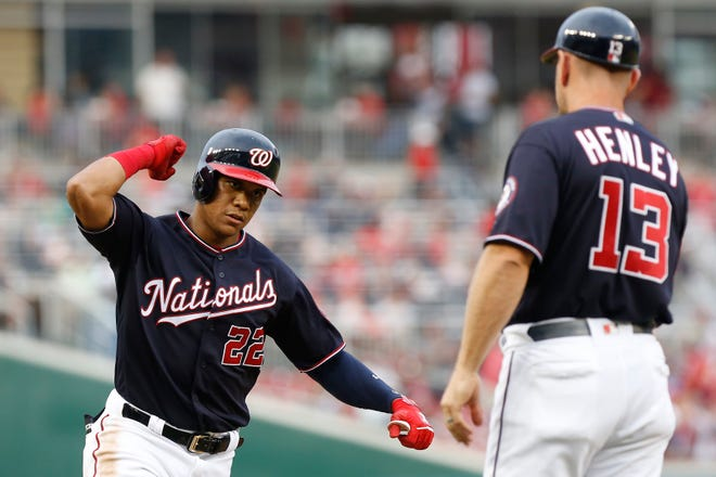 Nationals right fielder Juan Soto (22) celebrates after hitting a solo home run against the Braves.