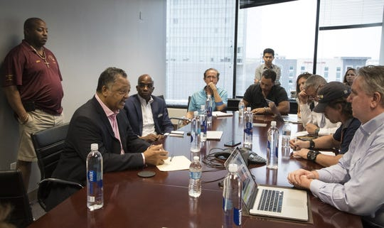 Jesse Jackson (left) answers a question during an interview in the editorial board room, Aug. 8, 2018, at The Arizona Republic.