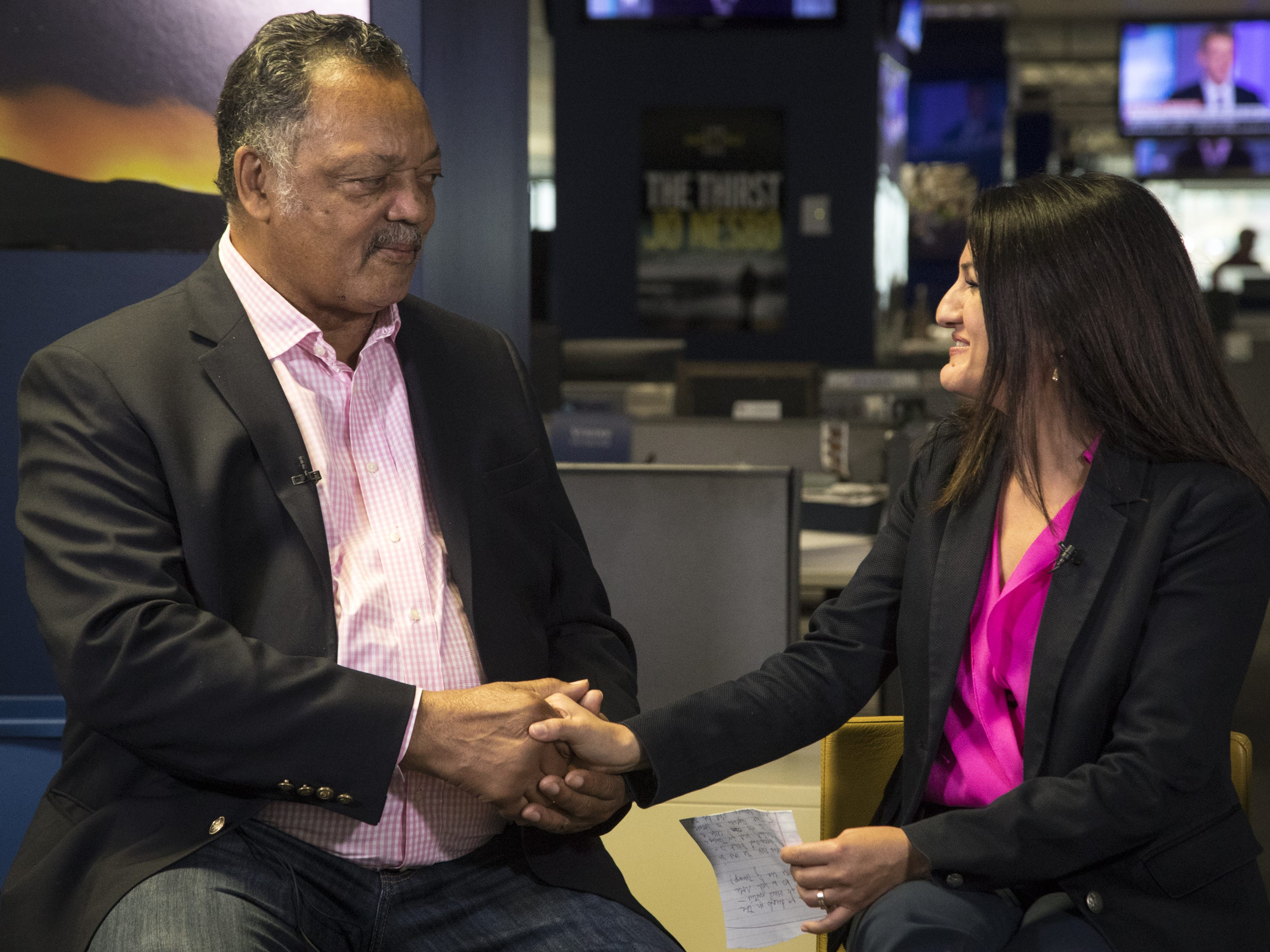 Yvonne Wingett Sanchez (right) greets Jesse Jackson during an interview on Aug. 8, 2018, at The Arizona Republic.